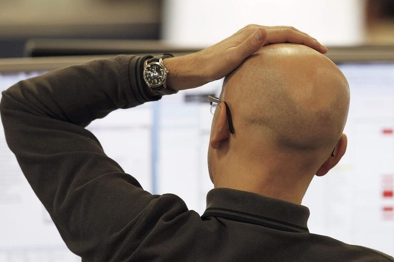 A trader checks screen data at the IG Index trading floor in London