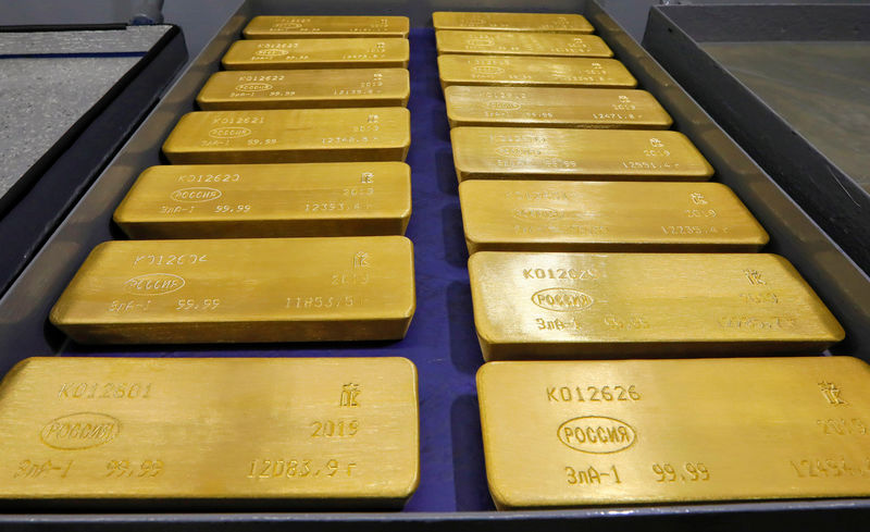 FILE PHOTO: Marked ingots of 99.99 percent pure gold are placed in a cart at a plant of Krastsvetmet in Krasnoyarsk